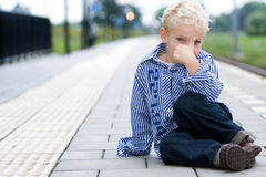 Boy at trainstation Royalty Free Stock Image