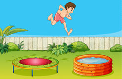 A boy on a trampoline Stock Images