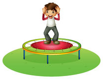 A boy on a trampoline Stock Photo