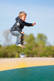 Boy Trampoline Jumping Stock Photo