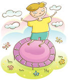 Boy and trampoline Royalty Free Stock Images