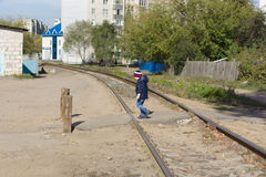 The boy transfers railway tracks Royalty Free Stock Image