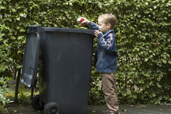 Boy Trashing A Can Stock Photography