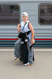 Boy with travel bag near  train Royalty Free Stock Photography