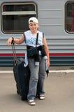 Boy with travel bag near  train Stock Image