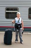 Boy with travel bag near  train Royalty Free Stock Photo