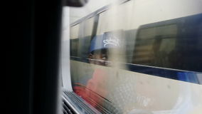 Boy travel in French train. FRANCE - CIRCa 2016: Handsome little boy looking out the fast train window to outside stock footage