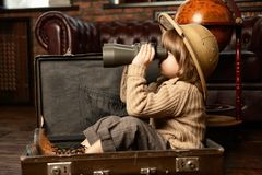 Boy in travel suitcase. Cute child boy in a travel suitcase playing at home. Childhood. Fantasy, imagination stock image
