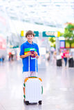 Boy traveling by airplane Royalty Free Stock Photography