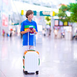 Boy traveling by airplane Stock Photos