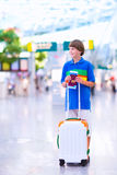 Boy traveling by airplane Stock Image