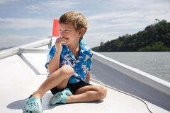 Boy traveling on boat Royalty Free Stock Image