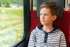 Boy travels by train Stock Images