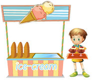 A boy with a tray beside an ice cream cart Stock Image