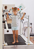 Boy on a Treadmill Stock Photo