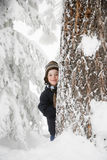 Boy and tree in the snow Stock Image