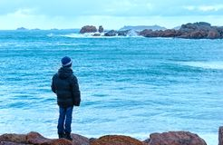 Boy and Tregastel coast view (Brittany, France) Stock Photos