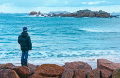 Boy and Tregastel coast view (Brittany, France) Stock Photography