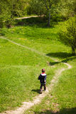 Boy on trekking path Royalty Free Stock Photo