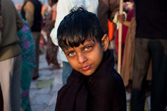 Boy trembling after swimming. Boy trembling from the cold after swimming in the holy Sangam during the biggest festival in the world - Kumbh Mela in Allahabad Stock Photography
