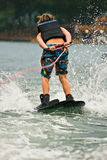 Boy on Trick Skis / Backwards. A young boy on trick skis skiing backwards stock photography