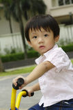 Boy on tricycle Royalty Free Stock Photos