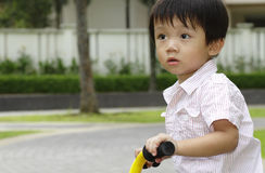 Boy on tricycle royalty free stock photo