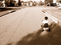 Boy on tricycle. Boy riding tricycle Royalty Free Stock Photos