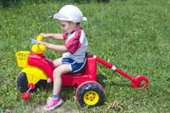 Boy with tricycle Royalty Free Stock Images