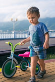 Boy with tricycle Stock Photo