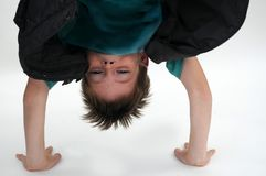Boy tries to do a handstand royalty free stock photo