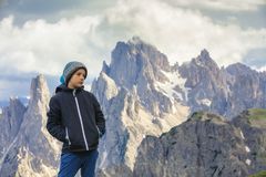 Boy on the trip in to the high mountains. royalty free stock photography