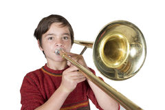 Boy with a trombone. Portrait of a boy playing the trombone Royalty Free Stock Image