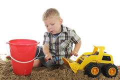 Boy, Truck, Sand and Pail Royalty Free Stock Images