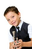 Boy with trumped. Boy dressed up with tie playing the  trumped isolated on white background Stock Images