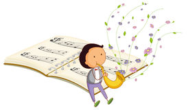 A boy with a trumpet and a music book at the back Stock Photography