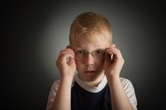Boy try on a glasses Stock Photos