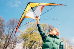 Boy try to start kite in the sky stock photography