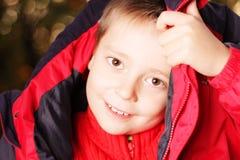 Boy trying put jacket on head Stock Photo