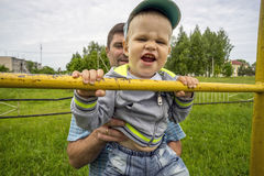Boy is trying to catch up on the bar Royalty Free Stock Image