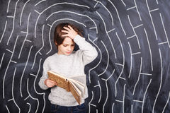 Boy trying to solve the maze Stock Photography