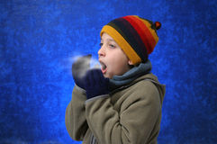 Boy trying to warm his hands Stock Images