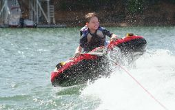 Boy Tubing Stock Images