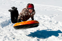 Boy tubing in the snow Stock Image