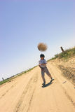 Boy with tumble-weed. Boy on the road Stock Photos