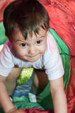 Boy in the tunnel toy. Boy playing in the tunnel toy Royalty Free Stock Image
