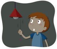 Boy turning off the light Royalty Free Stock Photo