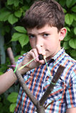 Boy with   turnpike aiming to the target Stock Photos