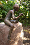 Boy and turtle sculpture Royalty Free Stock Photo