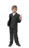 Boy in a tuxedo with a folder in hands. Stock Photo